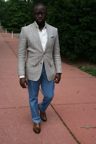 How to Wear Blue Dress Pants For Men: Definitive proof that a grey plaid blazer and blue dress pants look amazing when worn together in a refined look for a modern man. If in doubt as to what to wear on the shoe front, go with brown leather monks.