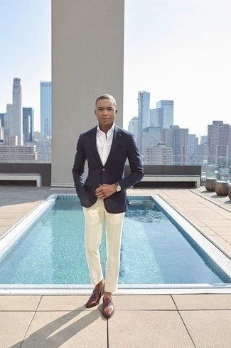 Men's Looks & Outfits: What To Wear In a Dressy Way: A navy blazer and beige dress pants are essential in a functional man's wardrobe. Add burgundy leather loafers to the mix and the whole outfit will come together brilliantly.