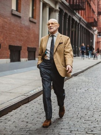 How to Wear Suspenders: Pair a tan blazer with suspenders to achieve new levels in your personal style. Take a classic approach with footwear and introduce a pair of brown suede oxford shoes to this outfit.