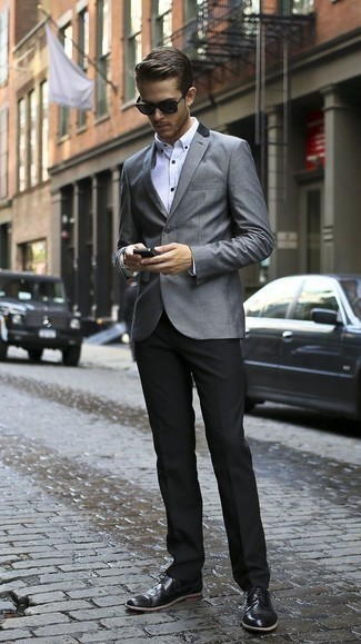 Fashion for 20 Year Old Men: What To Wear In a Dressy Way: This refined combo of a grey blazer and black dress pants will cement your outfit coordination skills. Black leather derby shoes are a savvy idea to complement your ensemble. Interested in fashion tips for 20-year-old gentlemen? This combo is pretty inspiring.