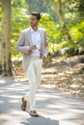 Fashion for 20 Year Old Men: What To Wear In a Dressy Way: This combination of a beige blazer and beige dress pants is incredibly stylish and provides a clean and proper look. If you don't know how to finish, add tan leather tassel loafers to your getup. This combo illustrates that cracking the fashion code as a 20-something is not that hard.