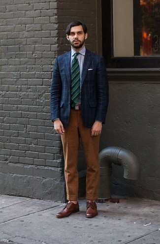 How to Wear a Navy Check Blazer For Men: This combo of a navy check blazer and tobacco dress pants is a never-failing option when you need to look like a real dandy. Brown leather derby shoes integrate seamlessly within many ensembles.
