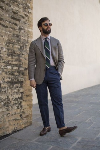 How to Wear a Grey Blazer For Men: This pairing of a grey blazer and navy dress pants is a safe option when you need to look truly smart and sophisticated. Dark brown leather loafers look awesome here.