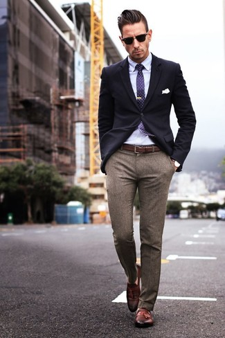 Something as simple as opting for a navy sportcoat and brown wool suit pants can potentially set you apart from the crowd. Brown leather tassel loafers will add some edge to an otherwise classic look.
