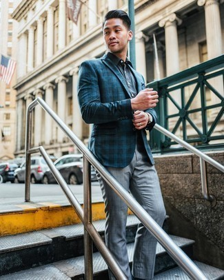 Navy Dress Shirt Outfits For Men: Combining a navy dress shirt and grey dress pants will cement your styling skills.