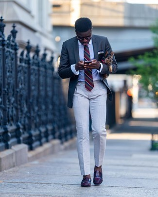 Charcoal Blazer Outfits For Men: Putting together a charcoal blazer and white dress pants is a fail-safe way to infuse your wardrobe with some manly elegance. Complement your ensemble with a pair of burgundy leather loafers and ta-da: the getup is complete.