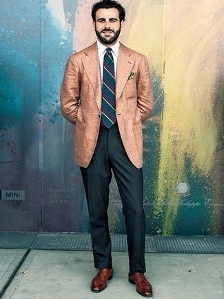 Black Socks Outfits For Men: A tan linen blazer and black socks married together are the ideal combo for those dressers who love casually dapper outfits. With shoes, you can take the classic route with a pair of brown leather derby shoes.