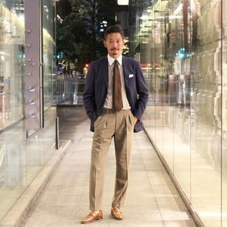 Khaki Dress Pants Outfits For Men: A navy blazer and khaki dress pants are absolute must-haves if you're crafting a classic wardrobe that matches up to the highest menswear standards. When it comes to shoes, add a pair of tobacco leather loafers to this outfit.