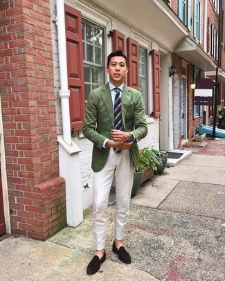 Olive Blazer Outfits For Men: An olive blazer and white dress pants are essential in any modern gentleman's wardrobe. Add dark brown suede tassel loafers to the mix and off you go looking smashing.