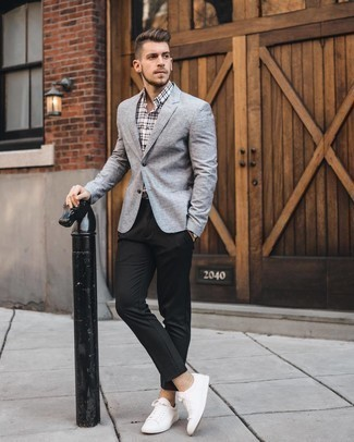 Grey Blazer with Black Dress Pants Outfits For Men: Indisputable proof that a grey blazer and black dress pants are amazing when paired together in a refined outfit for a modern gentleman. Finish off with white leather low top sneakers to add a confident kick to the getup.