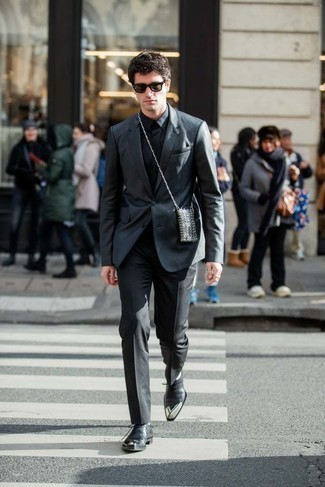 Dress Pants Outfits For Men: Teaming a charcoal blazer with dress pants is an on-point choice for a smart and elegant look. Add black and silver leather oxford shoes to the equation for extra style points.