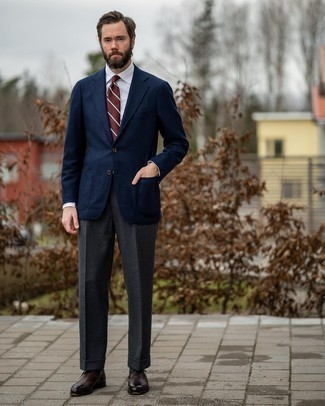 White Dress Shirt Outfits For Men: Teaming a white dress shirt and charcoal wool dress pants is a surefire way to inject manly sophistication into your styling lineup. If you're not sure how to round off, a pair of dark brown leather oxford shoes is a foolproof option.