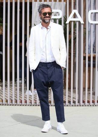 White Canvas High Top Sneakers Outfits For Men: This is indisputable proof that a white blazer and navy dress pants are awesome when worn together in a classy ensemble for today's guy. You can stick to a more casual route when it comes to footwear by slipping into white canvas high top sneakers.