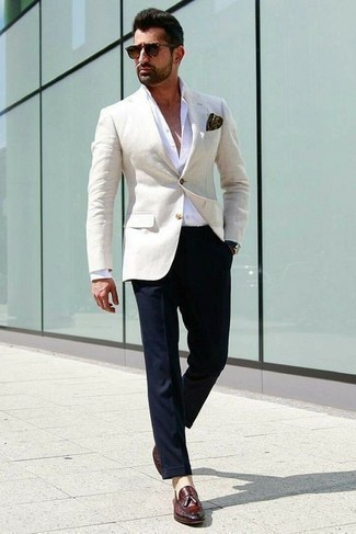 Navy Leather Watch Outfits For Men: Wear a beige blazer with a navy leather watch for a fashionable and easy-going outfit. Burgundy leather tassel loafers are guaranteed to breathe a dose of refinement into your look.