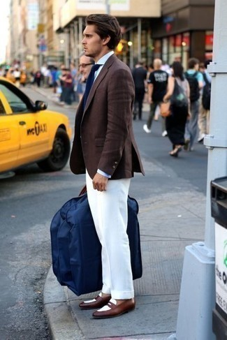Brown Leather Loafers Outfits For Men: Reach for a dark brown blazer and white dress pants if you're going for a proper, classic outfit. This getup is finished off really well with brown leather loafers.