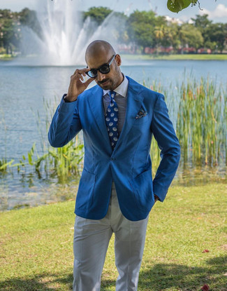 White and Navy Horizontal Striped Dress Shirt Outfits For Men: This classy combo of a white and navy horizontal striped dress shirt and white dress pants is a favored choice among the sartorially savvy chaps.