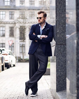 Black Leather Low Top Sneakers Outfits For Men: A navy blazer and charcoal dress pants are absolute mainstays if you're piecing together a polished closet that holds to the highest men's fashion standards. On the fence about how to finish off? Complete your ensemble with black leather low top sneakers for a more casual feel.