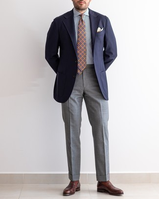 Navy Blazer with Grey Dress Pants Outfits For Men: Marrying a navy blazer and grey dress pants is a guaranteed way to infuse your wardrobe with some manly sophistication. A pair of dark brown leather loafers will pull this full look together.