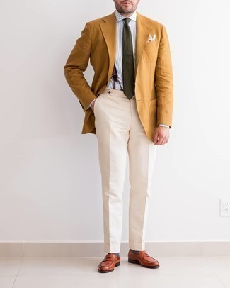 Suspenders Outfits: This relaxed combination of a tobacco blazer and suspenders is capable of taking on different forms depending on the way you style it out. To bring out an elegant side of you, introduce a pair of tobacco leather loafers to this outfit.