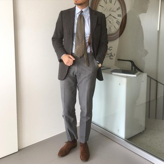 Suspenders Outfits: A charcoal wool blazer and suspenders paired together are a match made in heaven for guys who prefer relaxed styles. Take this getup in a dressier direction by sporting dark brown suede oxford shoes.