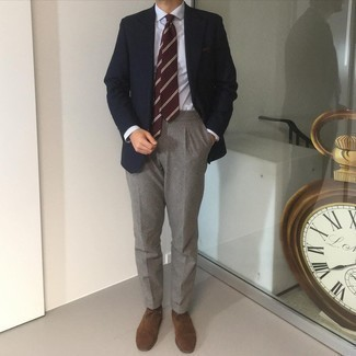 Navy Blazer with Grey Dress Pants Outfits For Men: This combination of a navy blazer and grey dress pants is a life saver when you need to look like a modern gentleman. We're totally digging how cohesive this outfit looks when completed by a pair of brown suede oxford shoes.