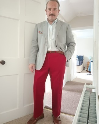 1200+ Outfits For Men After 40: This elegant combo of a grey blazer and red dress pants is a common choice among the dapper chaps. Introduce a pair of brown leather monks to the mix to tie the whole thing together. This pairing demonstrates that reaching your 40s is no reason to let your dressing standards drop.