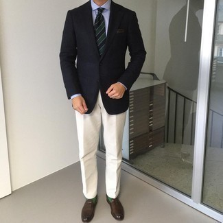 Light Blue Dress Shirt Outfits For Men: This combination of a light blue dress shirt and beige dress pants epitomizes manly refinement. If you need to immediately dress down your outfit with one single piece, why not introduce a pair of dark brown leather loafers to the equation?