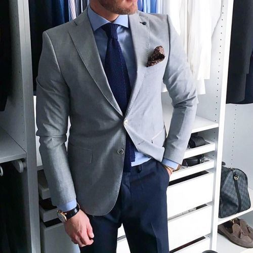 Grey suit jacket blue trousers