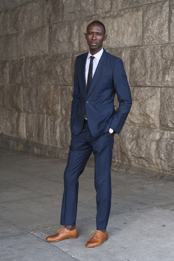 Try teaming a navy blazer with navy trousers for a sharp classy look. Make  tan