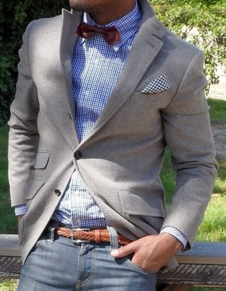 Perfect the smart casual look in a grey blazer and deep blue jeans.