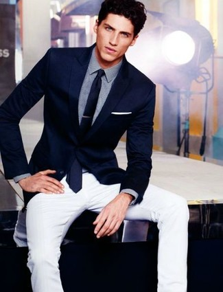 This pairing of a navy blazer and an Armani Collezioni Solid Satin Tie Navy is the perfect balance between formal and casual. You can't go wrong with this one on a extremely hot day.