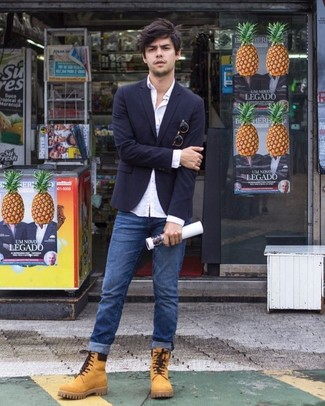For an ensemble that's super easy but can be dressed up or down in a myriad of different ways, pair a navy blazer with blue jeans. For a more relaxed take, grab a pair of tan suede work boots. Mastering spring fashion is easy with outfit inspo like this.