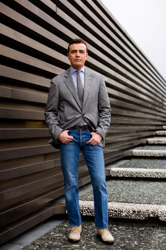 Grey Blazer with Blue Jeans Outfits For Men: A grey blazer and blue jeans are among those versatile pieces that have become the fundamental elements in our wardrobes. A pair of beige suede desert boots looks wonderful here.