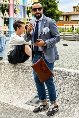 Grey Blazer with Blue Jeans Outfits For Men: Marrying a grey blazer with blue jeans is an on-point choice for a casually polished menswear style. Bring an easy-going touch to your outfit by finishing off with black and white suede low top sneakers.
