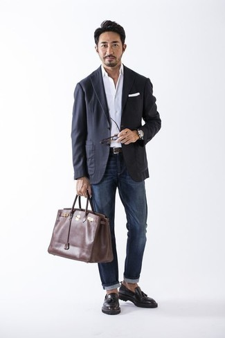 How to Wear a Brown Leather Tote Bag For Men: Why not rock a white dress shirt with a brown leather tote bag? As well as super practical, both pieces look great when worn together. To add a bit of classiness to this ensemble, complement this look with a pair of black leather tassel loafers.