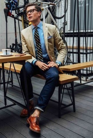 How to Wear a Tan Blazer For Men: This combo of a tan blazer and navy jeans is a fail-safe option when you need to look dapper but have no time. If you wish to instantly spruce up this outfit with a pair of shoes, why not complete this look with tobacco leather derby shoes?