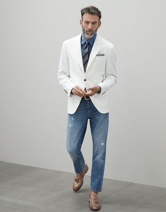 How to Wear a White Blazer For Men: The versatility of a white blazer and blue ripped jeans means they will be on constant rotation. Go ahead and introduce tan leather tassel loafers to the mix for an element of refinement.