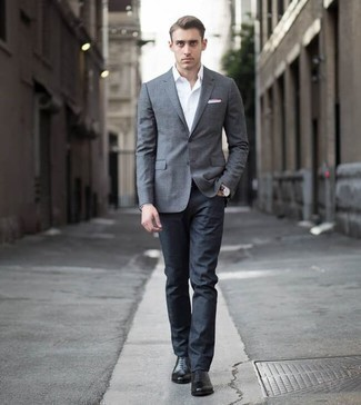 How to Wear Black Leather Oxford Shoes: A semi-casual pairing of a grey blazer and navy jeans can be relevant in many different occasions. Put an elegant spin on this look by rounding off with black leather oxford shoes.