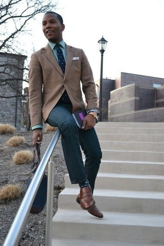 How to Wear a Blazer For Men: If the occasion calls for an elegant yet neat look, rock a blazer with navy jeans. To bring a little zing to your ensemble, grab a pair of brown leather loafers.