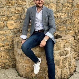 Grey Blazer with Blue Jeans Outfits For Men: Go for a grey blazer and blue jeans to assemble a casually classic and well-executed ensemble. White canvas low top sneakers will add a more relaxed touch to an otherwise all-too-safe ensemble.