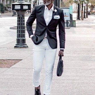 1200+ Outfits For Men After 50: For a casually stylish outfit, try teaming a black blazer with white jeans — these two items work beautifully together. Introduce charcoal canvas low top sneakers to your ensemble to instantly amp up the style factor of your outfit. If you often wonder how to dress your age, this ensemble is a great example.