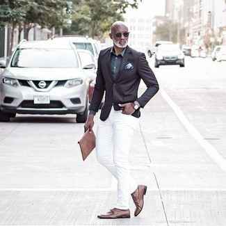 1200+ Outfits For Men After 50: A dark brown blazer and white jeans are the kind of a fail-safe combo that you need when you have zero time to spare. To introduce a little depth to your getup, complete your look with a pair of brown leather loafers. Wondering how to dress age-appropriately as you move into your 50s? This getup is the perfect answer.