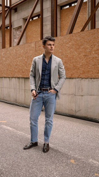 Navy Dress Shirt Outfits For Men: This pairing of a navy dress shirt and light blue jeans oozes sophisticated menswear style. If you wish to easily dial up your look with one piece, why not add a pair of dark brown leather loafers to your look?