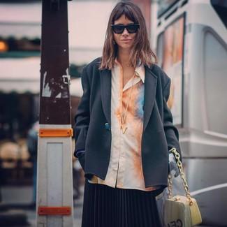 How to wear: black blazer, orange tie-dye dress shirt, black pleated midi skirt, yellow leather handbag