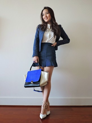 How to Wear a Blue Leather Satchel Bag: This off-duty combo of a navy blazer and a blue leather satchel bag is simple, seriously chic and oh-so-easy to imitate! White studded leather pumps are a simple way to add an extra touch of style to your outfit.