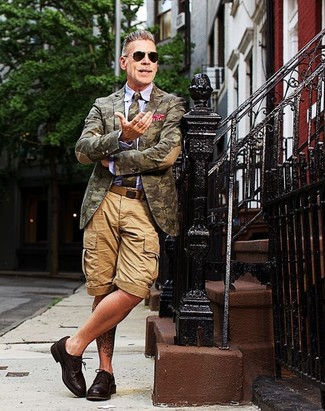 Nick Wooster wearing Olive Camouflage Blazer, Light Blue Dress Shirt, Tan Shorts, Dark Brown Leather Derby Shoes