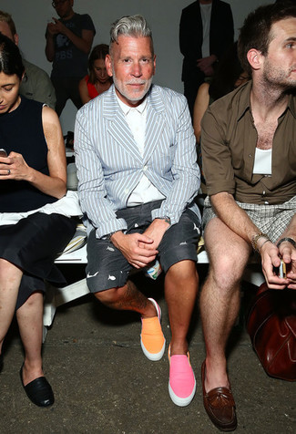 Nick Wooster wearing Light Blue Vertical Striped Blazer, White Dress Shirt, Charcoal Print Shorts, Orange Slip-on Sneakers