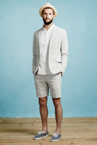 How to wear: grey blazer, white polka dot dress shirt, grey shorts, navy canvas low top sneakers