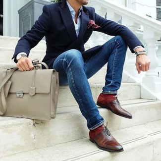 Rock a navy blazer with blue slim jeans for a work-approved look. A pair of oxford shoes will bring a strong and masculine feel to any ensemble.
