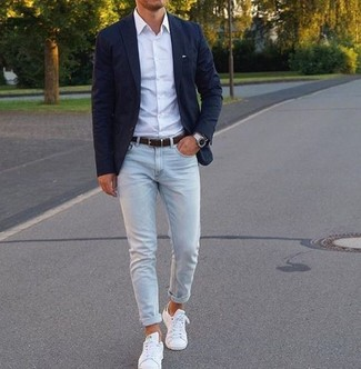 A navy blazer and light blue skinny jeans are great staples that will integrate perfectly within your current looks. Consider white leather low top sneakers as the glue that will bring your outfit together. There are plenty of ways to look neat and live through the heatwave, and this here is one of them.